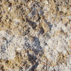 gebrochene bruchraue nuancierte Naturstein Beton Oberflaeche in Sandstein Beige