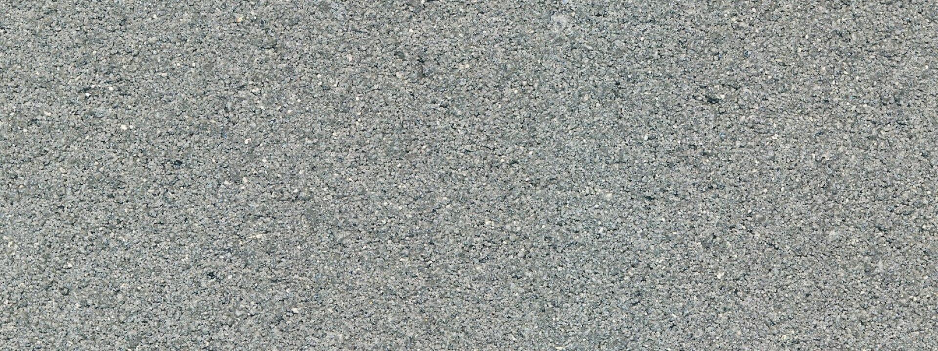 naturbelassene unbehandelte Standard Beton Oberflaeche in Grau